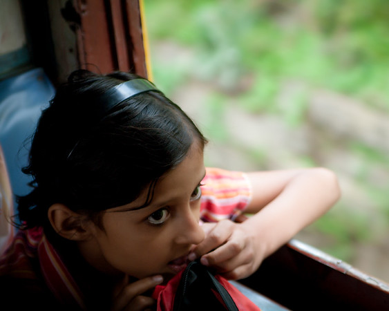 girl on toy train