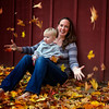 Anna and Liz Bussink playing in the leaves - one year old