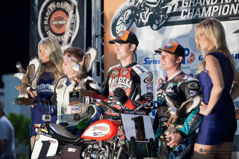 CALISTOGA, CA - OCTOBER 01: J. Johnson(center),  S. Halbert(left),  B. Smith(right) during ceremony at 2011 AMA Pro Flat Track Grand National Championship series, on October 01, 2011 in Calistoga, CA
