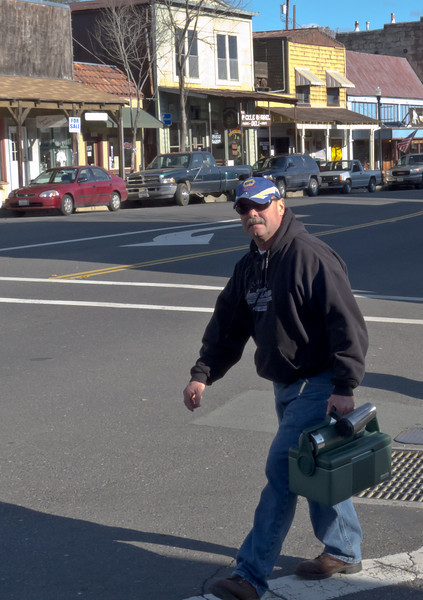 Working man on the street. Angels Camp, CA. March 2011.