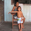 Grandmother and grandchild at their large house on stilts over the Amazon. Around Marajo Island. 2003.