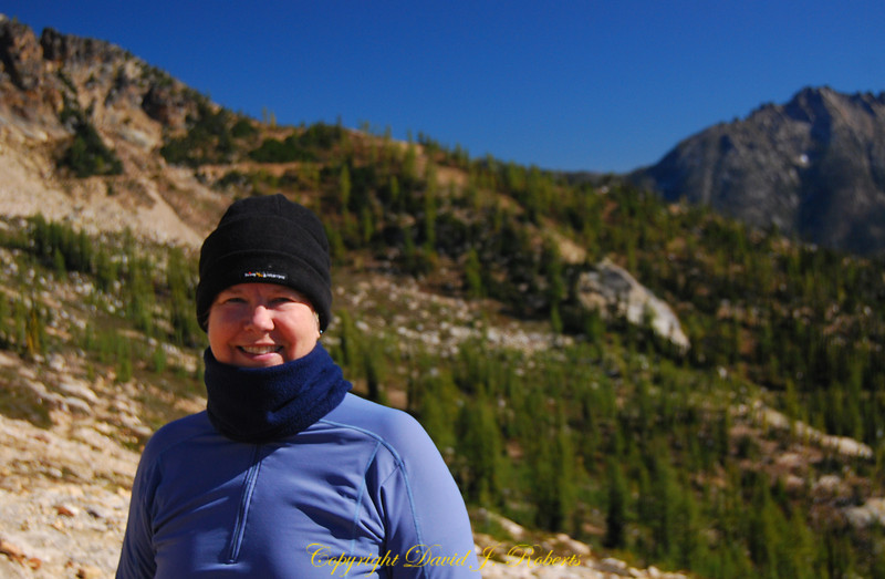 Allison in the wind and warm sun at Cutthroat Pass