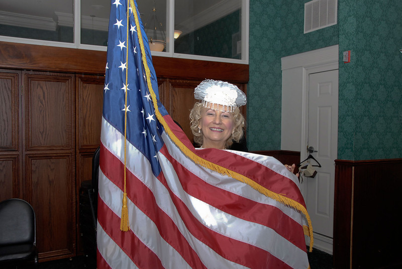 Waiting for the ceremony to begin, Linda showed off her patriotism