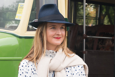 Girl in blue hat in front of a bus - The Goodwood Revival 2018