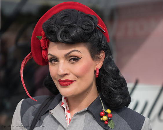 Woman with Red and Sprig - The Goodwood Revival 2018