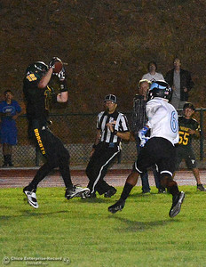 Riley Potthast catches a touchdown pass wiht seconds left in the game against Jamarquez Abrams (6) as Paradise beats Pleasant Valley in a football game Friday, Oct. 7, 2016, at Om Wraith Field in Paradise, California. (Dan Reidel -- Enterprise-Record)