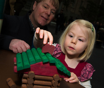 Adele (age 3) and David Dixon from Vienna VA tries their hand at Lincoln Logs