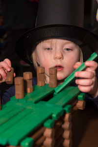 Poppy tries her hand at Lincoln Logs with a stovepipe hat she made herself