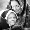 Lots of people in costume during this long weekend for Presidents Day. <br /> <br /> I came across this pair and was taken immediately by the connection between the two: a mother's love and a child's comfort in her arms. Powerful. Soothing.