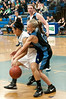 Whitman's Rachel Sisco attempts to steal the ball from Churchill's Kim Deausen.