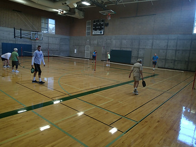 Playing pickleball at the local community sports center.