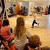 "Ben Breuch, 10, jumps up to explain want he was doing during the charades exercise.<br /> Tommy Hinkley and his wife, Tracey, own a business in Superior called Reel Kids. The pair teach kids and teens film and television acting.<br /> For a video about Reel Kids, go to  <a href=""http://www.dailycamera.com"">http://www.dailycamera.com</a>.<br />  Cliff Grassmick / September 17, 2011"