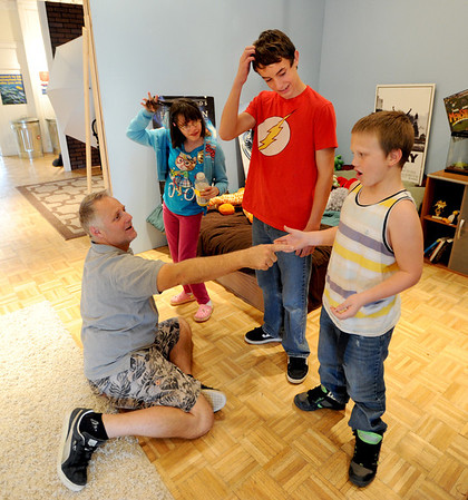 "Teacher, Tommy Hinkley, puts the kids on the spot for a quick response. Lizzy Zimmerman, left, Anton Pinkerton, and Piatt Pund participate in the exercise.<br /> Tommy Hinkley and his wife, Tracey, own a business in Superior called Reel Kids. The pair teach kids and teens film and television acting.<br /> For a video about Reel Kids, go to  <a href=""http://www.dailycamera.com"">http://www.dailycamera.com</a>.<br />  Cliff Grassmick / September 17, 2011"