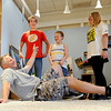 "Tommy Hinkley cracks up at the response of Anton Pinkerton, left, during a think on your feet exercise. Piatt Pund, center, and Katie Hinkley, were part of the exercise.<br /> Tommy Hinkley and his wife, Tracey, own a business in Superior called Reel Kids. The pair teach kids and teens film and television acting.<br /> For a video about Reel Kids, go to  <a href=""http://www.dailycamera.com"">http://www.dailycamera.com</a>.<br />  Cliff Grassmick / September 17, 2011"