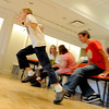 "Ben Breuch, 10, jumps up to take his turn in the charades exercise.<br /> Tommy Hinkley and his wife, Tracey, own a business in Superior called Reel Kids. The pair teach kids and teens film and television acting.<br /> For a video about Reel Kids, go to  <a href=""http://www.dailycamera.com"">http://www.dailycamera.com</a>.<br />  Cliff Grassmick / September 17, 2011"