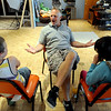 "Tommy Hinkley, center, gives a pep talk to Piatt Pund, left, and Lizzy Zimmerman, before class.<br /> Tommy Hinkley and his wife, Tracey, own a business in Superior called Reel Kids. The pair teach kids and teens film and television acting.<br /> For a video about Reel Kids, go to  <a href=""http://www.dailycamera.com"">http://www.dailycamera.com</a>.<br />  Cliff Grassmick / September 17, 2011"