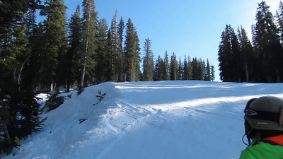 """Ethan, through woods off lip onto groomer, 180 w tip grab.  """"Best Rider on the Mountain"""""""