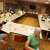 Lunch and graduation at Buzzell Senior Center for Wilmington seniors who completed the Remembering When program. There were 33 participants in the six-month program of monthly meetings to learn about fire and fall prevention, and about 25 attended the lunch. (SUN/Julia Malakie)