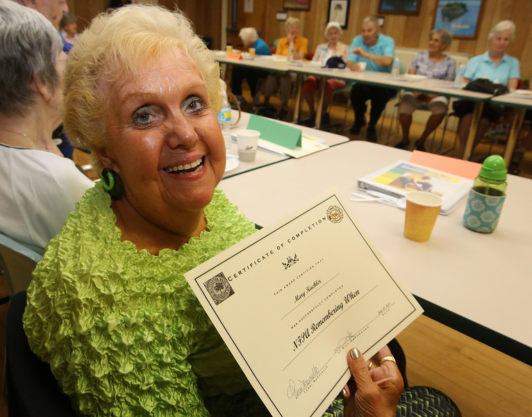 Lunch and graduation at Buzzell Senior Center for Wilmington seniors who completed the Remembering When program. There were 33 participants in the six-month program of monthly meetings to learn about fire and fall prevention, and about 25 attended the lunch. Mary Kuchler of Wilmington holds up her certificate. (SUN/Julia Malakie)
