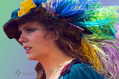 Beauty in Hat ~ This woman was attending the Renaissance Faire.  I loved her feathered hat.