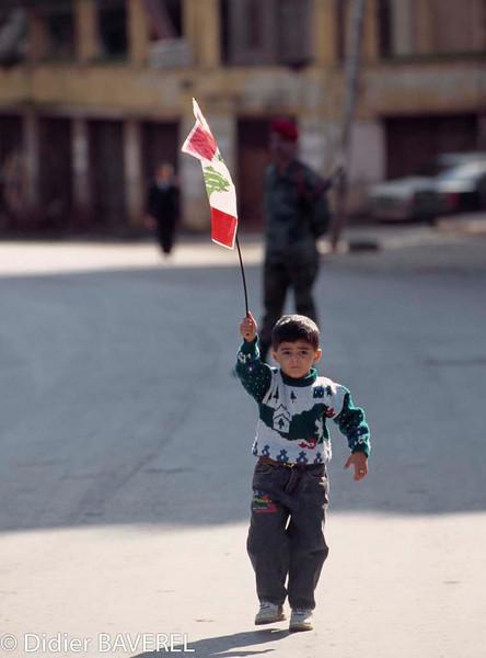 February 1995, Beirut, Lebanon --- A Lebanese child holds high the national flag. --- Image by © Didier Baverel/Kipa/Corbis