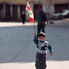 February 1995, Beirut, Lebanon --- A Lebanese child holds high the national flag. --- Image by © Didier Baverel/Kipa/Corbis