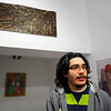 New Revival Gallery resident artist Leandro Lopez, 21, of Fitchburg talks about a piece of his artwork, displayed above, in the gallery on Main St. in Fitchburg, Wednesday.<br /> SENTINEL & ENTERPRISE / BRETT CRAWFORD
