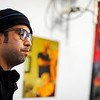 Fitchburg artist Camilo Neves, 30, talks about the new resident artists at the Revival Gallery on Main St. in Fitchburg, Wednesday.<br /> SENTINEL & ENTERPRISE / BRETT CRAWFORD