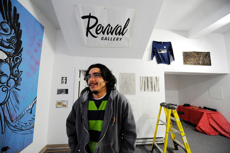 New Revival Gallery resident artist Leandro Lopez, 21, of Fitchburg talks in the gallery on Main St. in Fitchburg, Wednesday.<br /> SENTINEL & ENTERPRISE / BRETT CRAWFORD