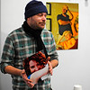 New Revival Gallery resident artist Tim Daoust, 34, of Ashburnham talks about his photography work in the gallery on Main St. in Fitchburg, Wednesday.<br /> SENTINEL & ENTERPRISE / BRETT CRAWFORD