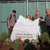 Whiffle ball field at Mulligan Park, off Plain Street in Lowell, is dedicated to former Lowell resident Calvin Riley, who was killed while playing Pokemon Go last summer in San Francisco. From left, parks commissioner Tom Bellegarde, Cal's brother Justin Riley, 18, sister Bria Riley, 11 tomorrow, and mother Kariann Riley, all of San Mateo, CA, and grandmother Linda Riley of Lowell. (SUN/Julia Malakie)