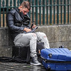 Street Entertainer takes a smoke break