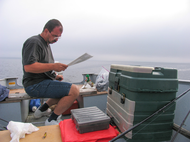 Dinu reviewing his notes from my past fishing lessons - Grand Lake Stream - July 2006