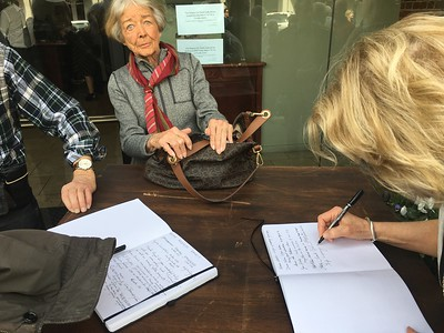 Signing guest books outside - and my initial meeting with Pat (center).