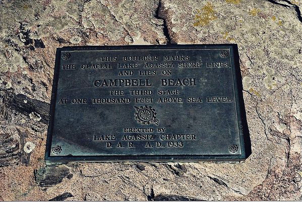 This Boulder Marks <br /> The Glacial Lake Agassiz Shore Lines<br /> And Lies On<br /> Campbell Beach<br /> The Third Stage<br /> At One Thousand Feet Above Sea Leval<br /> <br /> Erected By<br /> Lake Agassiz Chapter<br /> D.A.R. A.D. 1933