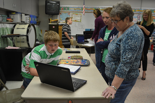 Braiden Overbeck shares a presentation with his grandmother, Nelda Everett, and his mother, Tanya Overbeck, about the state Rhode Island at his fourth grade social studies class.