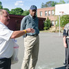 """Mike Bangrazi, former Boston Celtic and Hall of Famer Jones and City Councilor Mark Bodanza talk to the crowd at the Bennett School basketball court on Saturday afternoon. Jones was given a proclamation from the city, naming June 4th """"Sam Jones Day"""". SENTINEL & ENTERPRISE / Ashley Green"""