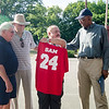 """Dick Fontaine, Freddie Scherer and Mike Bangrazi present former Boston Celtic and Hall of Famer Sam Jones with a basketball jersey at the Bennett School basketball court on Saturday afternoon. Jones was given a proclamation from the city, naming June 4th """"Sam Jones Day"""". SENTINEL & ENTERPRISE / Ashley Green"""