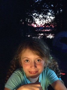 Sam camping at Chickahominy Riverfront Park with the sun setting behind her.