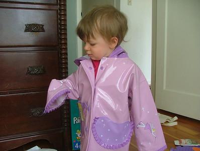 Sam checks out her new raincoat