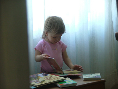 Reading in her room