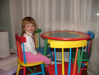 Sam tries out her newly painted table and chairs, courtesy of Dad