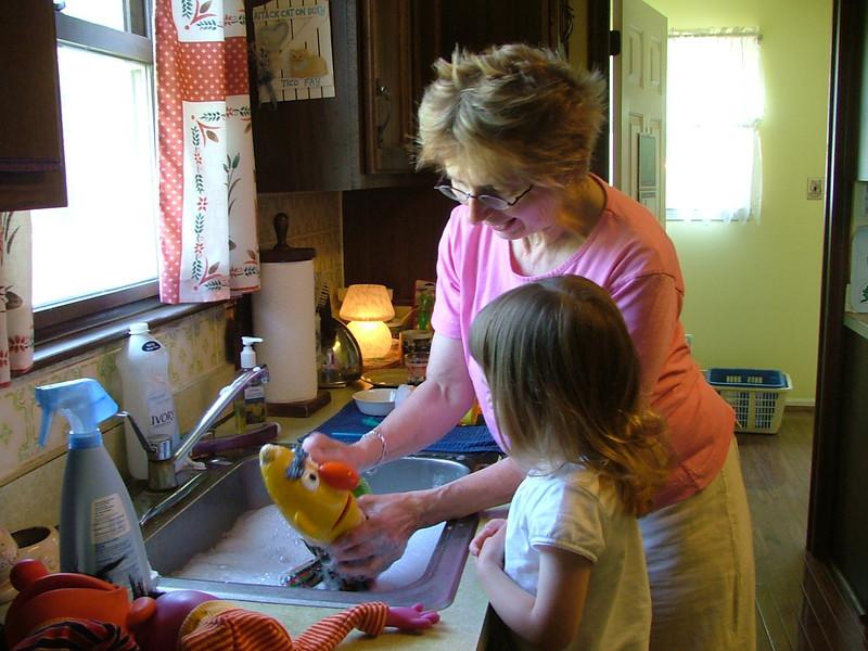 Sam and Mom-mom wash the Sesame Street Pupets