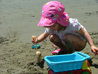 Digging in the sand at Keller Beach