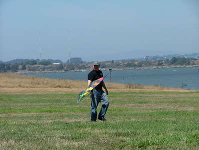 Daddy gets ready to fly his stunt kite