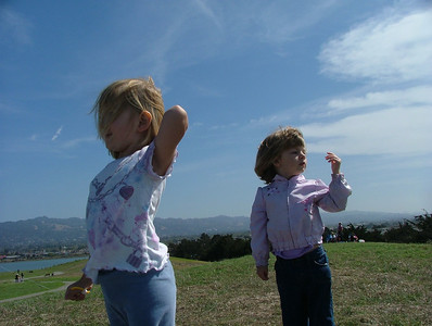 Meri and Sam brave the wind at Cesar Chavez park