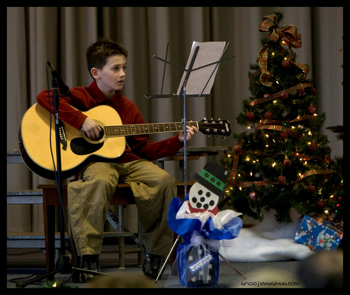 "Hammering out a kick butt version of ""Here Comes Santa Clause"" at the Lowes Elementary Christmas Program. 2008 Sam"