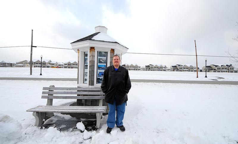 Scott Lanciani, president of the Board of Directors for the New Whalom Cooperative, stands by a gazebo by Lake Whalom, Friday, that was dedicated to the old Whalom Park. Lanciani is trying to bring the park back to the area.<br /> SENTINEL & ENTERPRISE / BRETT CRAWFORD