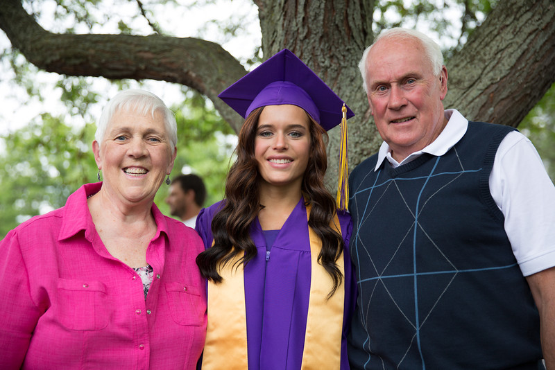 The graduate with Grandma and Grandpa.