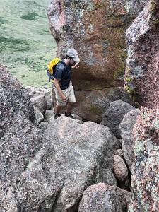 Navigating the summit rocks.